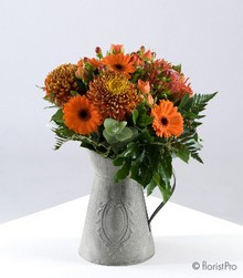 Orange blooms in a rustic jug container