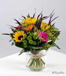 Pink yellow orange green flowers in a glass vase