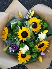 Sunflower Helianthus bouquet with rolled leaves and green chrysanthemum
